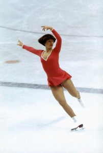 INNSBRUCK, AUS - 1976: Dorothy Hamill skates on right skate with both arms posed above her head and left leg back during the Winter Olympics skating competition in 1976 in Innsbruck, Austria. Dorothy Hamill wins the gold medel for the USA in the Womes Figure skating competition. (Photo by Tony Duffy/Getty Images) *** Local Caption *** Dorothy Hamill